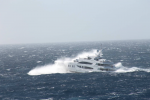 The yacht was designed to function not just as a floating palace but as a seagoing vessel--and as it crossed the Atlantic a few weeks ago, it was clobbered by a violent storm. These photos were taken by a passing freighter.  Photo: ©Patty Witler Anderson.